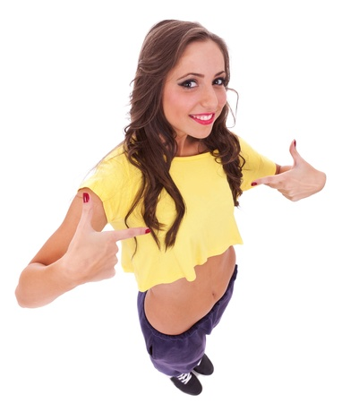 young casual sporty woman pointing to her self on white background, picture from above photo