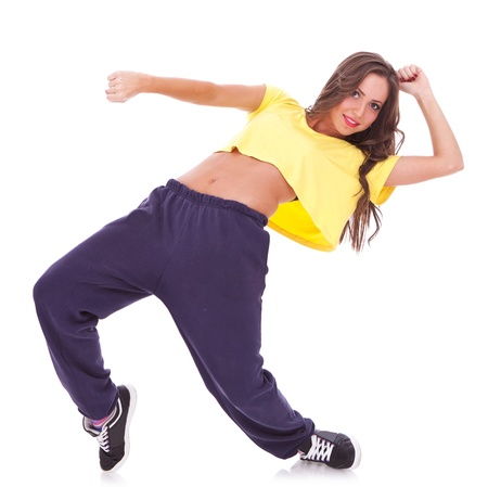 New pretty modern slim hip-hop style woman dancer break dancing isolated on a white studio background  photo