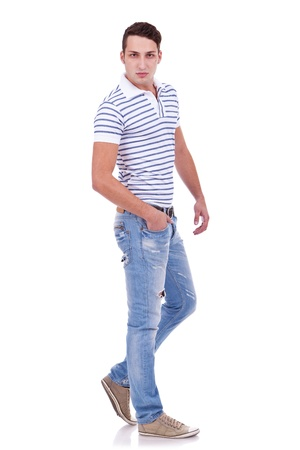 Full length portrait of happy handsome young casual man isolated on white background  photo