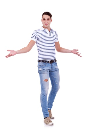 Full length portrait of a casual man gesturing welcome isolated on white background  photo
