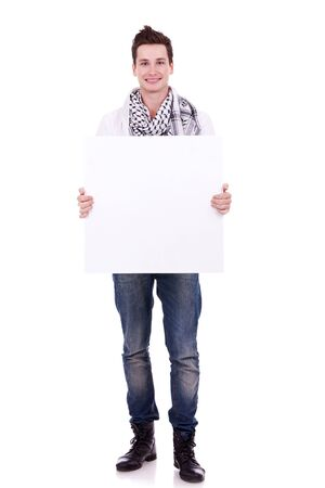 casual man displaying a banner ad isolated over a white background  photo