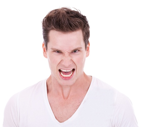 young man screaming at the camera on white background photo