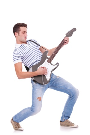 Full length of young man playing guitar isolated on white background  photo