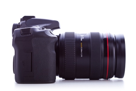 dslr camera: side view of a digital photo camera with zoom lens on whit ebackground