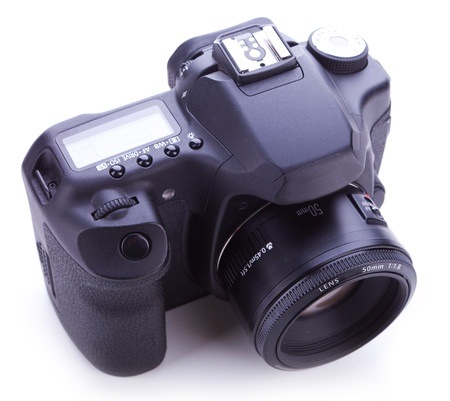 telezoom: picture from above of a digital photo camera with 50mm lens on white backgroun