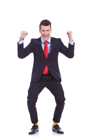 funny looking business man in suit and yellow socks, winning on white background photo