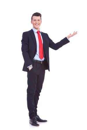 cheerful young business man greets you an white background photo