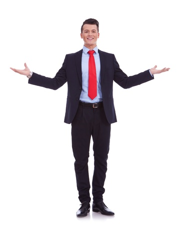 Approachable young business man with open arms , welcoming you on white background photo