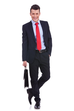 Business man with briefcase standing on white background  Stock Photo - 14637629