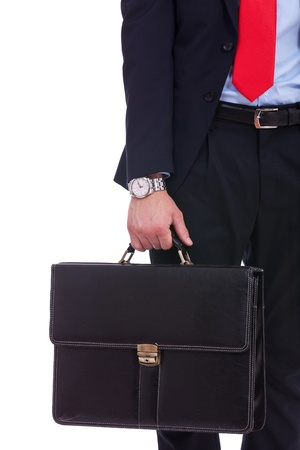 leather briefcase: Business man in black suit hand holding briefcase  on white background