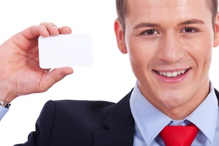 Business man showing a blank business card over white background  Stock Photo - 14637742