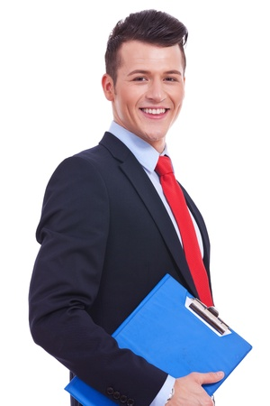 clipboard isolated: Smiling modern businessman holding blank clipboard in hands isolated on white