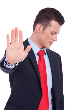 Business man showing stop gesture on white background photo
