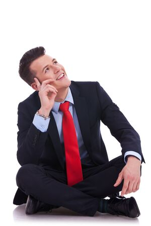 young seated business man looking up above his head and smiling Stock Photo - 14637708