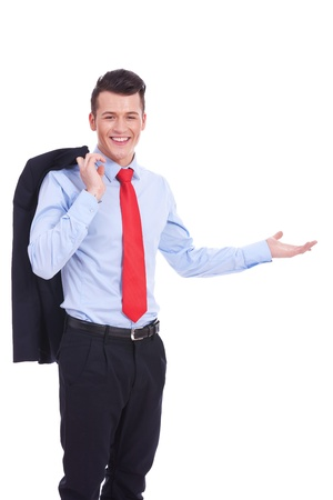 over shoulders: Portrait of relaxed young business man with coat over shoulders welcoming you on white background