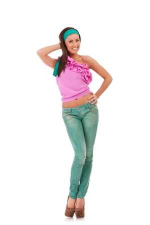 hot legs: beautiful girl wearing jeans  and high heeled shoes posing on white background  Stock Photo