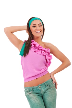 young sexy woman in a fashion pose , smiling to the camera onwhite background photo