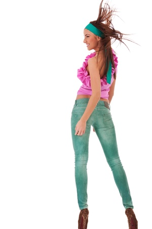 back view of a sexy young woman in jeans and high heels shoes looking to her left side photo
