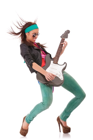 rock and roll babe wearing leather jacket and sunglasses playing an electric guitar on white background photo