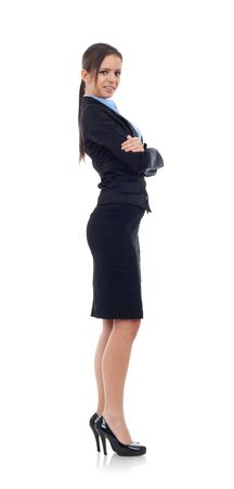 Full length, side view of a confident young business woman standing with crossed hands isolated over white background  photo