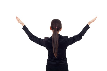 Young business woman with her hands opened. back picture on white background. photo