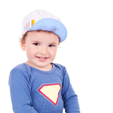 waistup: Waist-up picture of a beautiful little child smiling. He has a nice summer cap. Isolated on white.