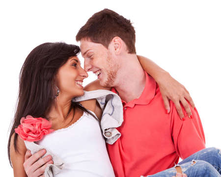 eachother: sweet couple facing eachother and smiling. he is holding her in his arms Stock Photo