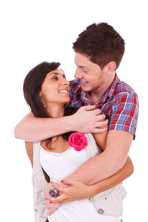 eachother: Young couple embracing and facing eachother, isolated on white background