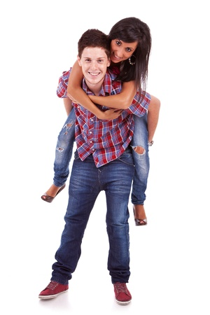 piggy back: Portrait of man holding his girlfriend on his back against a white background