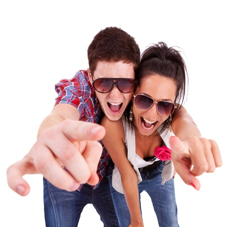picture of a young couple pointing at you and screaming  photo