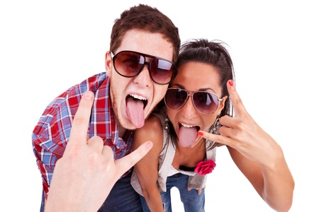 roll out: party couple screaming and showing rock and roll sign while sticking their tongues out. against a white background