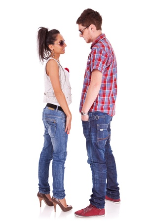 eachother: Full length picture of a cute couple standing face to face , looking at eachother over white background
