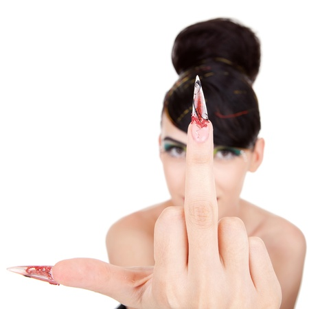 Awesome brunette young woman showing an obscene sign withher middle finger photo