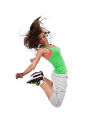 latin dance: Happy new modern slim hip-hop style woman dancer jumping isolated on a white studio background  Stock Photo