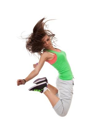 baile latino: Happy new moderno delgado hip-hop mujer estilo bailarina que salta aislado en un fondo blanco de estudio Foto de archivo