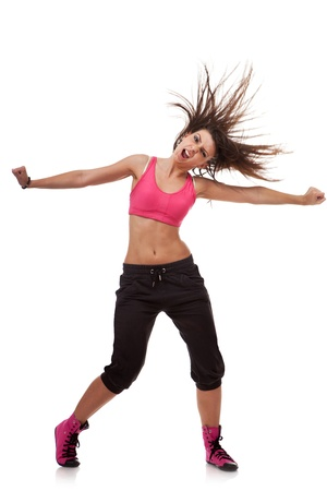 young dancer: screaming beautiful young dancer posing with arms stretched out over white background Stock Photo
