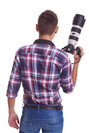 Back view of a professional male photographer holding his big camera . isolated on white background Stock Photo - 15025080