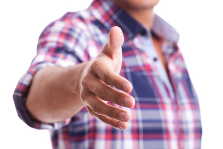 A casual young man is offering to shake hand on white Stock Photo - 15023920