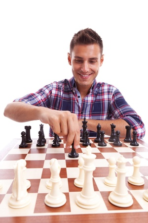 pawn adult: Young casual man playing chess with a happy expression on his face. On white background.
