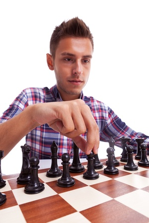 pawn adult: Young casual man preparing to make his first move. Isolated on white background.
