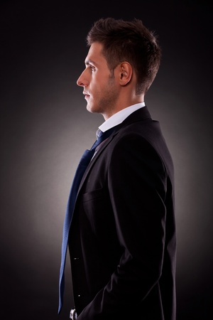 side view of a young businessman looking forward Stock Photo - 15024336