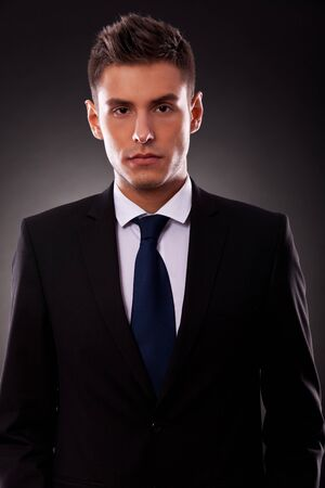 Portrait of a handsome young businessman looking seriously at camera photo
