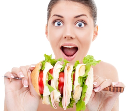 large woman: young woman being surprised by the size of her sandwich  Stock Photo