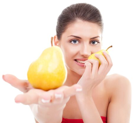 healthy young woman holding two pears, offering one to you and holding one for herself. isolated on white  photo