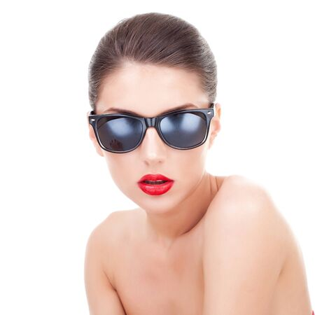 nude fashion model: Sexy young woman with sunglasses looking at the camera, over white background