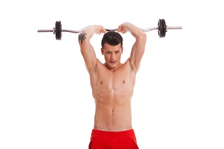 shirtless guy: Muscular young man lifting a barbell above head. exercising for triceps, over white