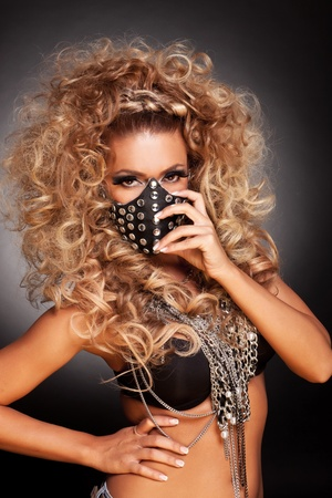 youns sexy sado masochist woman putting on her mask Stock Photo - 15154795