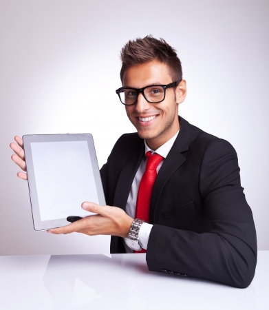 young business man presenting his new and cool tablet pad Stock Photo - 15500377