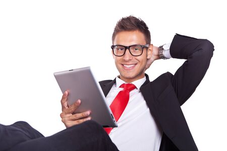 electronic pad: relaxed business man using electronic pad tablet on white background
