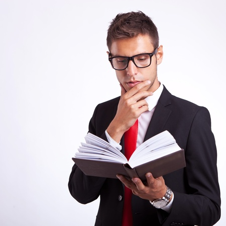 relaxed and pensive business man reading a book Stock Photo - 15500482